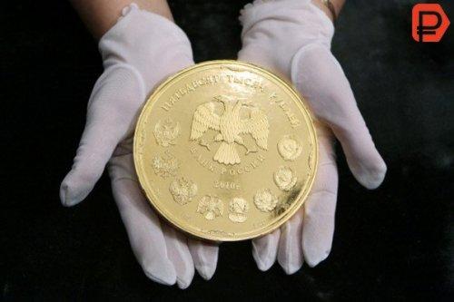 Путин выпустил монету